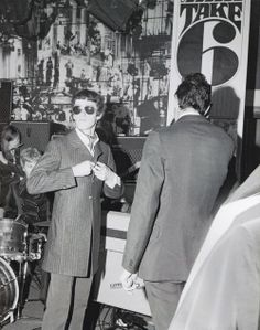 Shoppers in the Carnaby Street boutique Take Six (1966)