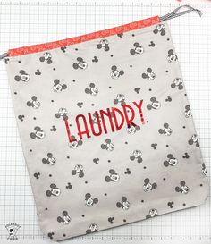 How to Make a Drawstring Laundry Bag; A Fat Quarter Project How to make a drawstring laundry bag using fat quarters, a simple fat quarter project. Beginner Sewing Patterns, Bag Patterns To Sew, Sewing For Beginners, Library Bag, Kids Library, Fat Quarter Projects, Disney Fabric, Sewing Projects For Kids, Sewing Ideas