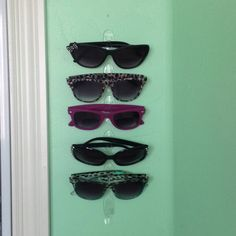 Just me being creative. Hang sunglasses on your wall with small clear command hooks by 3M