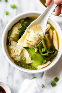 Loaded with vegetables, this quick and easy wonton soup is super simple, and takes under 15 minutes to make thanks to the frozen wontons. #wontonsoup #easysoup #souprecipe #skinnytaste