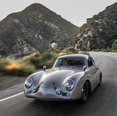 Stunning silver Porsche on the road. #i particularly like the leather straps.