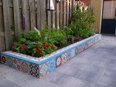 Some left over cement tiles create a great and happy border in your garden!