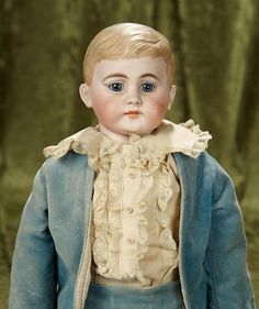"""Rendezvous Auction on Wednesday, April 26th at 7PM EST. 22"""" German bisque """"American Schoolboy"""" with wonderfully sculpted brown hair. $400/500"""