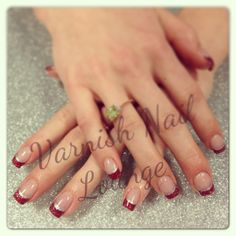 Red acrylic sparkle w/ silver line Xmas/New Year nails