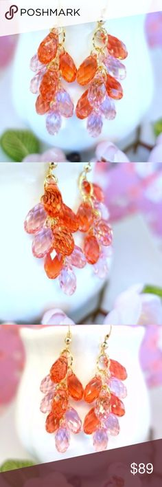 Orange and pink Swarovski crystal gold earrings This is a sparkly pair of orange and light pink Swarovski crystal gold filled chandelier earrings that are simply gorgeous and hand made by me. These are one of a kind earrings with beautiful sparkly 5x12mm Swarovski crystals. There are 4 faceted carmine pink and light pink Swarovski crystal tear drop briolettes attached to each earring that are transparent and very sparkly. They come with gold filled earring hooks and chain hoops that are…