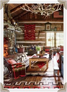 RL's COLORADO GUEST CABIN LIVING ROOM Overlooking the cabin's living room is a chandelier made with naturally shed elk antlers; beside the hearth, a woven-twig rocking chair is draped with a vintage Capps Indian-trade blanket, and an antique New Mexico pine table stands atop an early-20th-century Navajo rug.