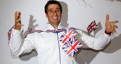 217a: Here we have a French athlete wearing British flags, which we believe to be a sign of international goodwill. He's smiling and clearly ecstatic to be at the Olympic games representing his country. Even his body language exudes happiness. The cropping is really bad (there's something on top that should've probably been cut out), which makes for a surprisingly unprofessional picture.
