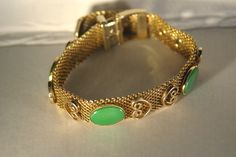 Collectible Costume Jewelry - Vintage Gold-tone Mesh Buckle Bracelet with Green Cabochon. $15.00, via Etsy.