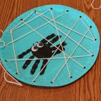 We drew the spiders rather than hand prints and for very small ones we cut slits in the edges instead of holes.