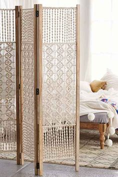 Magical Thinking Tabitha Macrame Foldable Screen - Urban Outfitters - inspiration - the screen is damned near $500, almost a mortgage ppyment. But 6 1x2s, 6 hinges, and a few skiens of beigey-white cotten, along with some hooking skills...