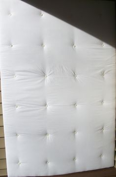idea for padded cell walls. Think this is quilt batting attached to a board. Dirty it up & perfection.