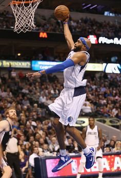 Vince Carter #25 of the Dallas Mavericks gets the slam dunk against the San Antonio Spurs at American Airlines Center on January 25, 2013 in Dallas, Texas.