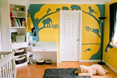 A Bright Yellow & Blue Mural in a baby nursery.