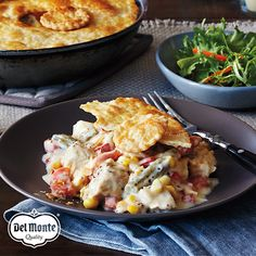 Turkey Skillet Pot Pie - Carrots, corn and green beans are mixed with leftover turkey or chicken and a creamy sauce for a comforting yet quick dinner classic. It's cleverly topped with a pre-baked piecrust just before serving from the skillet.