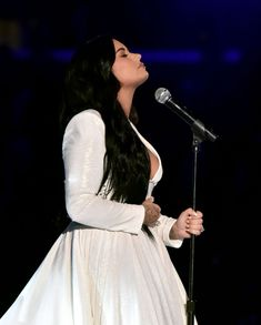 Demi Lovato performs onstage during the Annual GRAMMY Awards. Anyone, please send me anyone. Lord, is there anyone? - Anyone by Demi Lovato Disney Channel, Concert Fashion, Lauren London, Christian Siriano, Girl Crushes, Selena Gomez, Queens, Idol, White Dress