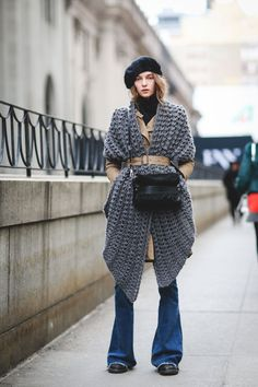 If you thought your sweater had to go underneath your jacket, think again. Reverse the order, and utilize the coat's belt to tie everything together. Now you're making a statement. #refinery29 http://www.refinery29.com/2016/02/103173/ny-fashion-week-fall-winter-2016-street-style-pictures#slide-178