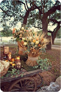 An old farm wagon acts as decor for an outdoor, autumn wedding / Embellished Weddings