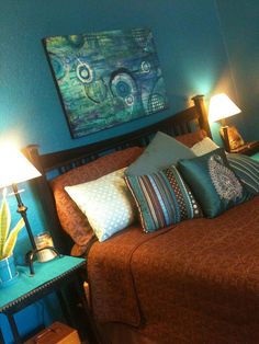 Our turquoise + marine blue + chocolate brown bedroom.