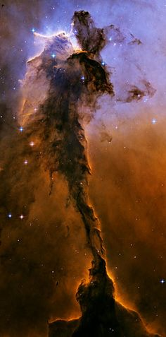 Stellar spire in the Eagle Nebula  Appearing like a winged fairy-tale creature poised on a pedestal, this object is actually a billowing tower of cold gas and dust rising from a stellar nursery called the Eagle Nebula. The soaring tower is 9.5 light-years or about 90 trillion kilometres high, about twice the distance from our Sun to the next nearest star