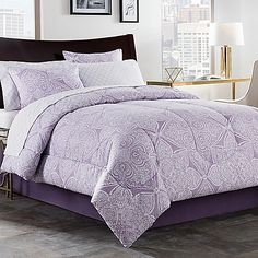 Dress your bed with the graceful medallions and florals of the Lea Comforter Set. Showcasing a beautiful blend of purple and white hues, this gorgeous set brings elegance to your space. The set includes a comforter, shams, bed skirt, and sheet set.