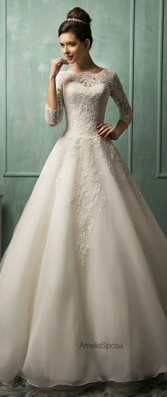 pretty traditional and modest wedding dress with 3/4 length lace sleeves and high neckline with ball gown shape