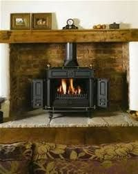 Image Result For Free Standing Fireplace With Corner Raised Hearth Corner Wood Stove Wood Burning Stove Corner Woodburning Stove Fireplace