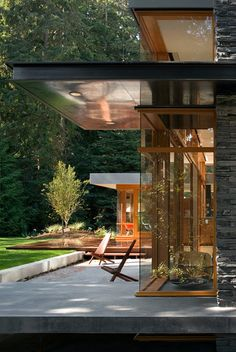 This previously dark and disorganized 1950s mid-century modern home was redesigned by architecture studio Bohlin Cywinski Jackson to meet the needs of a young family who desired a sense of transparency and light to take advantage of the serene qualities of their wooded site in Seattle, Washington.
