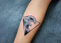 Wave tattoo in a triangle frame. Apart from the circle frame, the triangle frame also helps in making the wave look powerful and strong.