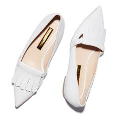The epitome of the feminine pointy-toe flat, these are made extra special with the addition of preppy fringe and cushy white leather. The elegant silhouette...