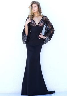 Scalloped, sheer lace long bell sleeves frame the lace bodice with V-neckline and empire waistline of this Sherri Hill 50610 full-length dress. This fitted gown has a cutout lace back and finishes in a sweep train.