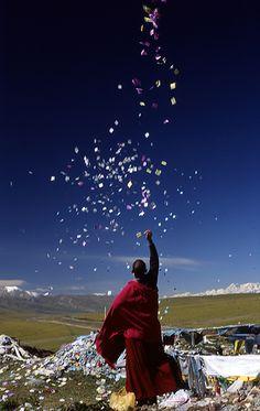 Buddhist monk sending Prayers in the wind in Tibet People Around The World, Around The Worlds, Little Buddha, Tibetan Buddhism, Buddhist Monk, Bhutan, Beautiful World, Serenity, Tibet