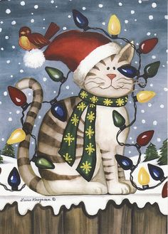 Even cats and birds get along at Christmas.