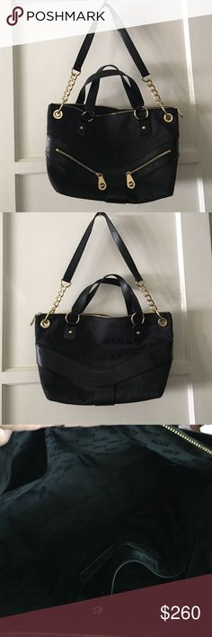 MK Purse Black on black with black lining.......gold hard ware.  Has two little pockets in front.   You can put your lipstick or change!  Has zipper pouch inside and the other side has two pockets.  Zips closed.  Beautiful purse!   Used 2 times only!    Can be use as a cross body or just the handles! Michael Kors Bags Crossbody Bags