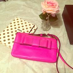 Kate spade cross body Hot pink Kate spade cross body with bow accent on the front. Will come with dust bag. Light wear. No trades. kate spade Bags Crossbody Bags