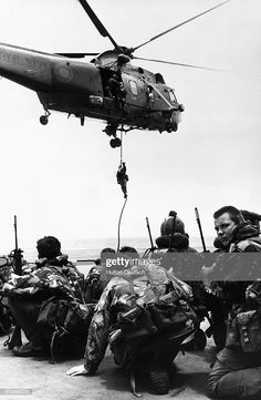 Waiting to be lifted by a Westland Sea King helicopter, Royal Marines from 40 Commando crouch on the flight deck of HMS Hermes, which heads the naval task force bound for the Falkland Islands. Pin by Paolo Marzioli Marina Real, Falklands War, Royal Marines, Royal Navy, Military History, Stock Pictures, Royalty Free Photos, Fighter Jets, British