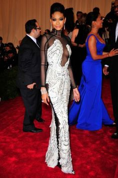 The 10 Best-Dressed Style Stars At Last Night's Met Ball: Tom Ford and Chanel Iman make the perfect pair with this sexy-but-elegant gown. We love the detailed pattern, the exposed seams, and the unusual fabric pairings. That, and the fact Chanel can pull off a turtleneck while still looking so sultry. The hair, makeup, and jewelry finish it off to perfection.   [May 2012]