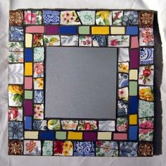 Creating a mosaic out of old dinner plates and china.