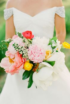 Bouquet of Pink Peonies, Coral Charm Peonies, Yellow Ranunculus, and White Gardenias and Magnolias | Brides.com