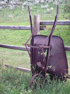 Rustic Wheelbarrow against fence