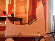 """Frozen"" sleigh. Plastic Red Rider wagon converted to sleigh, using cardboard and white Duck tape...."