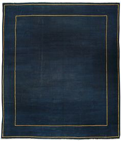 A Chinese rug BB3626 - A modern early 20th century Chinese antique rug, the open dark blue field and border with a pair of thin gold lines ...