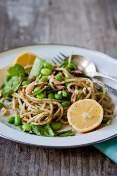 Lemony Pesto Pasta with Edamame and Almonds, sounds summery and like a good way to try out a new vegetable :)