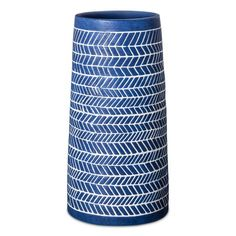 Whether filled with flowers or standing alone, the Threshold Tall Ribbon Vase in Blue makes an elegant statement. This blue chevron vase makes a great centerpiece or works as an accent on a shelf.