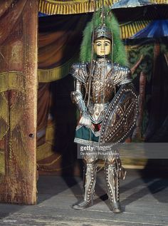 Sicilian puppet, Orlando Paladino (Roland) is always depicted with crossed eyes, because he has gone mad for love. Puppet theatre marionette, Sicily, Italy, Opera of the Puppets (UNESCO Masterpieces of the Oral and Intangible Heritage of Humanity, 2001). Palermo, Museo Etnografico Siciliano Pitrè.