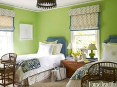 Fun bright green and blue color combo and love the quilts at the end of the bed.
