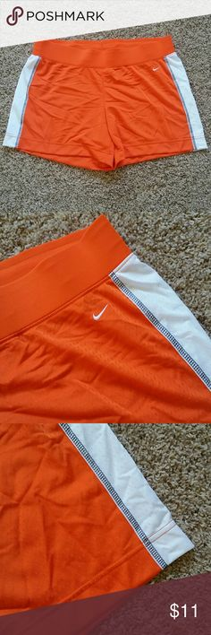 New Nike women's orange shorts New Nike women's orange shorts with white accents.  Comfy very soft jersey like material in 100% polyester, thick elastic waistband with draw string. New never worn but no tags. Nike Shorts