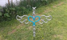 Spiked Winged Heart Horseshoe Cross by MECrazyLadyCreations
