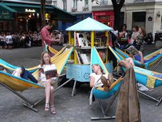 Mobile library in Paris - is a crowdsourced design by Amandine Lagut. The design features an electric tricycle mobile library that deploys 7 hammocks around it.