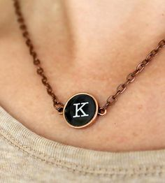 This lovely vintage-style necklace makes a delightful gift for bridesmaids, new moms and people who have initials (that should be just about all of ya). The initial necklace is made with a replica of an old typewriter key, in either black or white, which is then surrounded by copper and strung from a nickel free chain. These typewriter keys and are waterproof and won't rust.
