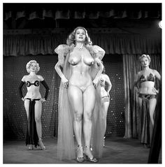"""Tempest Storm A publicity still from the 1953 Burlesque film: """"A NIGHT IN HOLLYWOOD"""", features Ms. Storm framed between: Misty Ayres (Left) and Jenna Saunders (Right).. The film was shot at the 'FOLLIES Theatre'; located in Los Angeles, California.."""